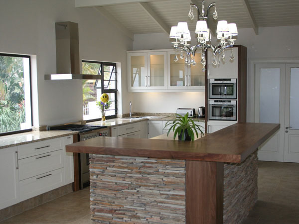 white painted kitchen with wood top