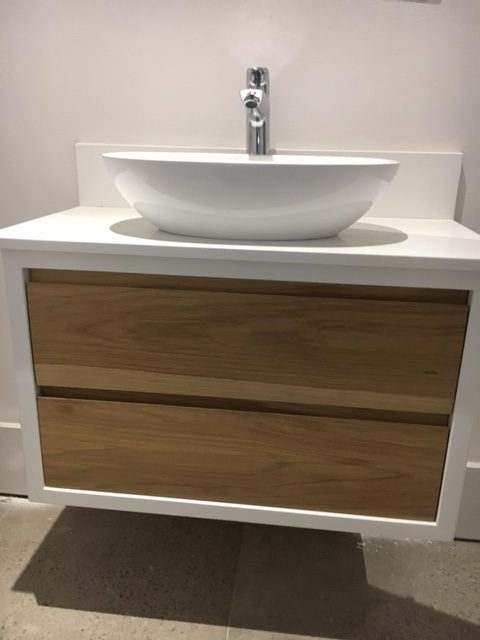 white wood toilet basin with silver tap